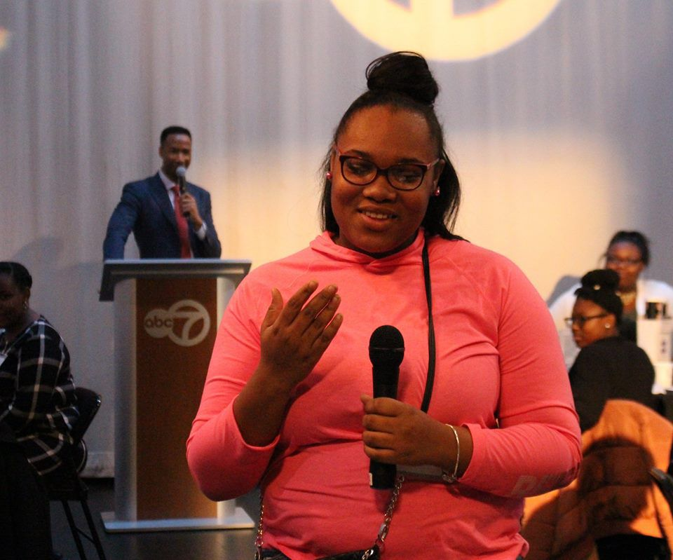 """Alyssa Times, a sophomore at Christ the King Jesuit College Prep, shares what she learned from the professional she was paired with at """"The Black Table,"""" a Black History Month event sponsored by BUILD, Inc.   Photo credit: Daniel Perez"""