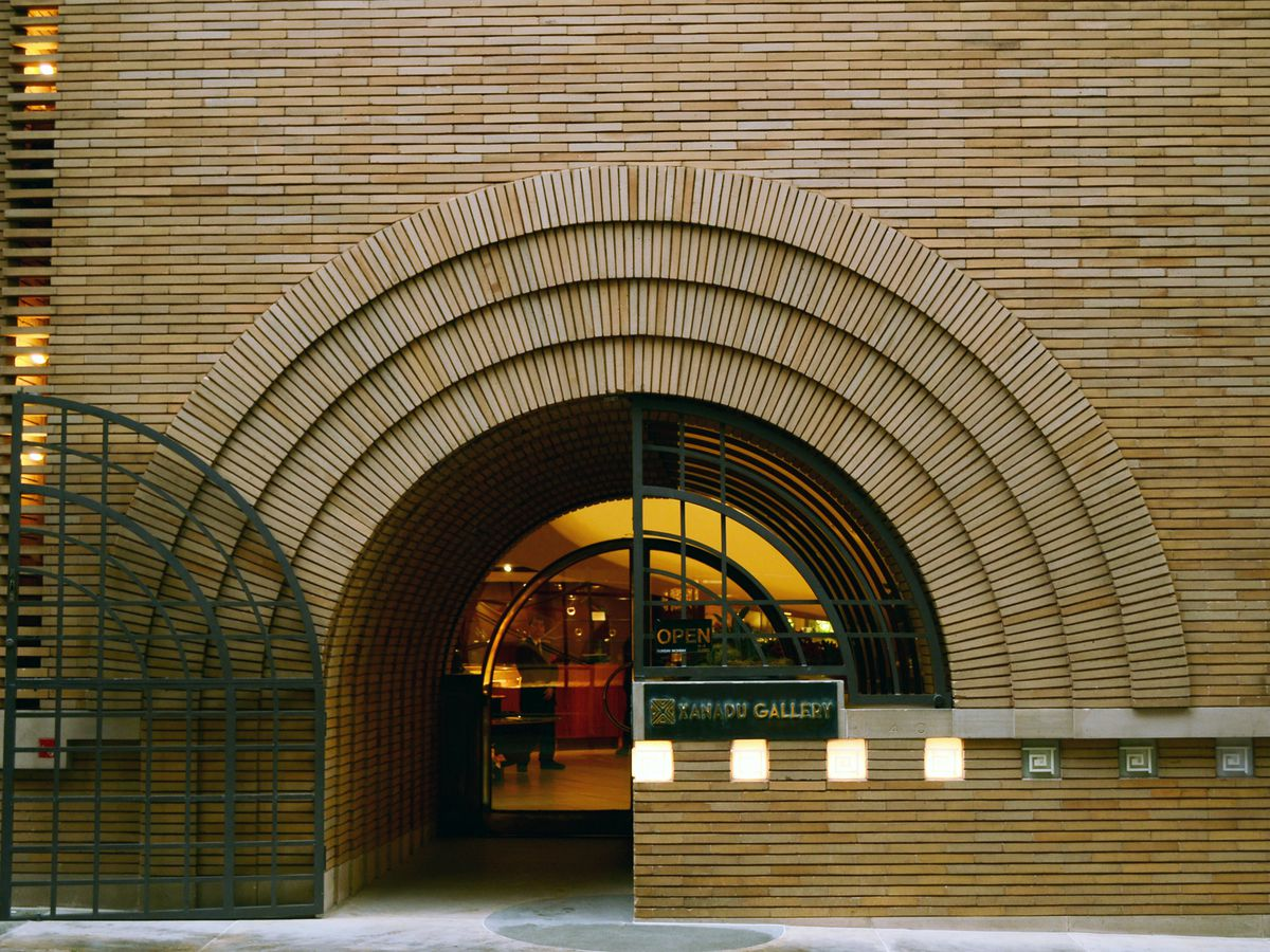 The exterior of the V.C. Morris Gift Shop in San Francisco. The facade is tan brick with an arched glass entryway.