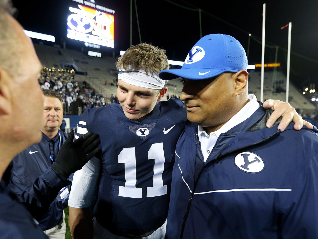Brigham Young Cougars quarterback Zach Wilson (11) talks with Brigham Young Cougars head coach Kalani Sitake as they celebrate the 49-23 win over Hawaii at LaVell Edwards Stadium in Provo on Saturday, Oct. 13, 2018.