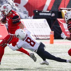 Utah Utes quarterback Jake Bentley (8) carries the ball against Washington State Cougars defensive back Armani Marsh (8) during an NCAA football game at Rice-Eccles Stadium in Salt Lake City on Saturday, Dec. 19, 2020.