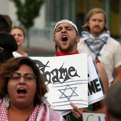 Hisham Arafat, center, participates in a pro-Palestine rally in Salt Lake City, Thursday, July 31, 2014.