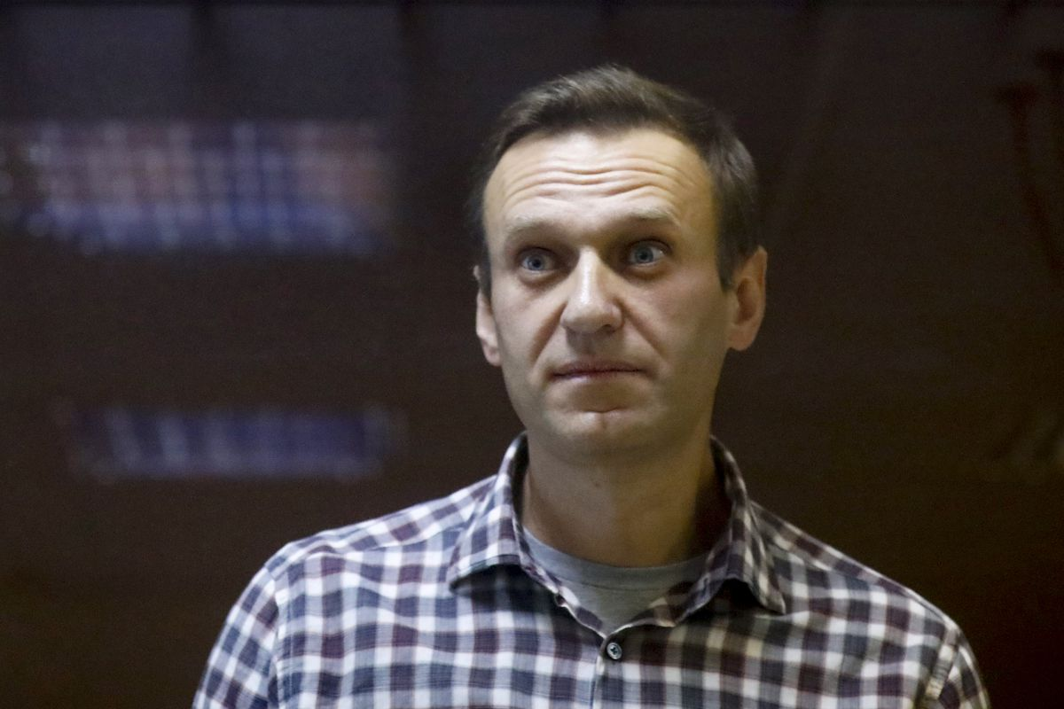 In this Saturday, Feb. 20, 2021 file photo, Russian opposition leader Alexei Navalny stands in a cage in the Babuskinsky District Court in Moscow, Russia.