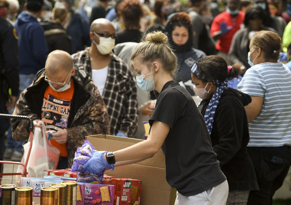 Large Crowd Comes Out For Community Food Distribution During Coronavirus COVID-19 Outbreak