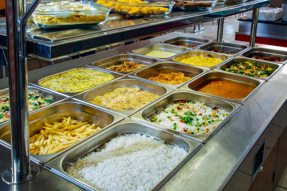 A hot bar with different kinds of foods.