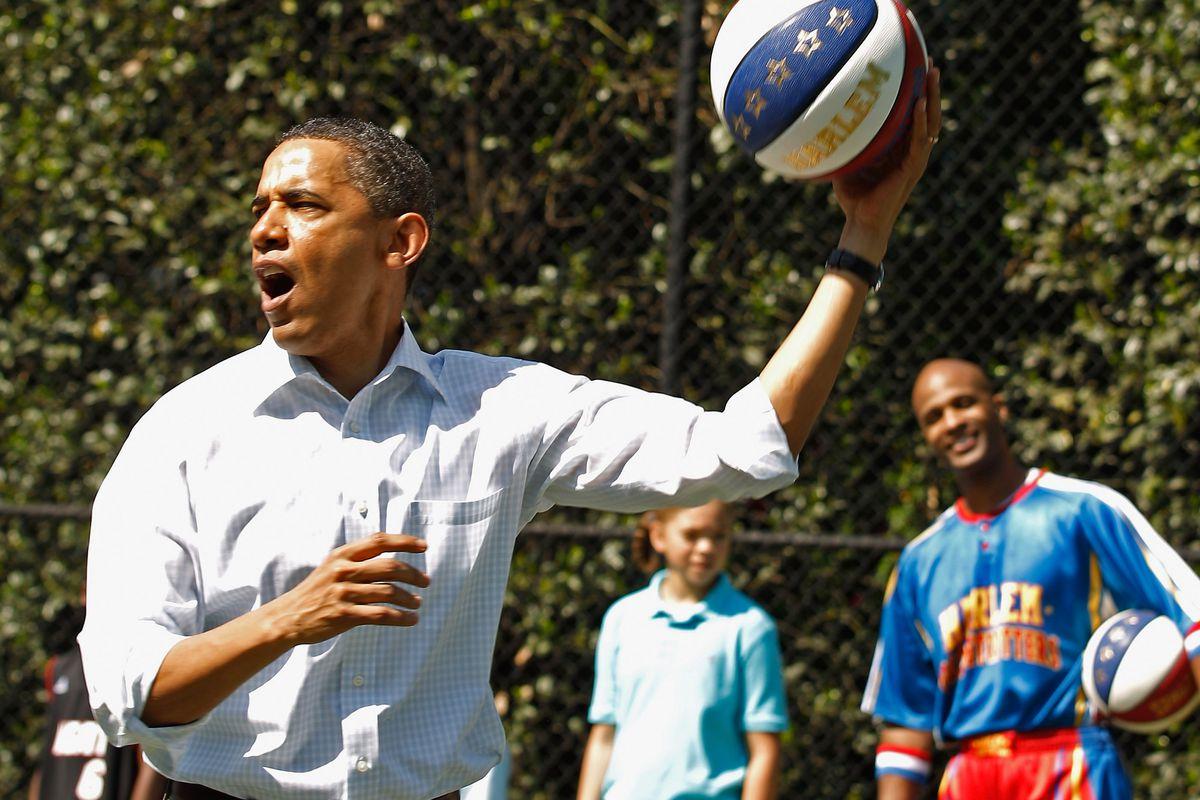 Barack Obama plays a basketball game