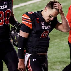 Utah Utes quarterback Jake Bentley (8) and his teammates leave the field after their loss to the USC Trojans at Rice-Eccles Stadium in Salt Lake City on Saturday, Nov. 21, 2020.