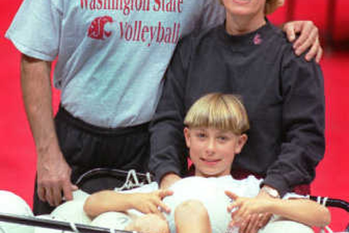 The kid in the picture is Ali Farokhmanesh, son of former longtime WSU volleyball coach Cindy Fredrick and her husband Mashallah Farokhmanesh. Nice haircut, kid!