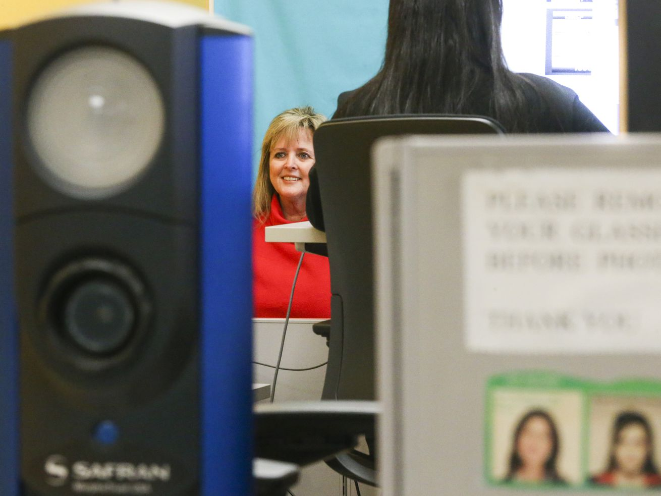 Jodie Jones gets a picture taken for her driver's license at the Driver License Division of the Utah Division of Motor Vehicles in Salt Lake City on Monday, Dec. 16, 2019. Federal and state lawmakers are scrambling to construct rules to ensure emerging facial recognition technology is not deployed in a manner that infringes on Fourth Amendment protections.