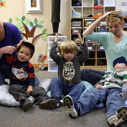 Benjamin, left, Zander and Ty participate in circle time with tutors Kris Bradford, back left, and Madison Fujimoto during the Autism Bridges program at Kids on the Move in Orem, Tuesday, Oct. 15, 2013.