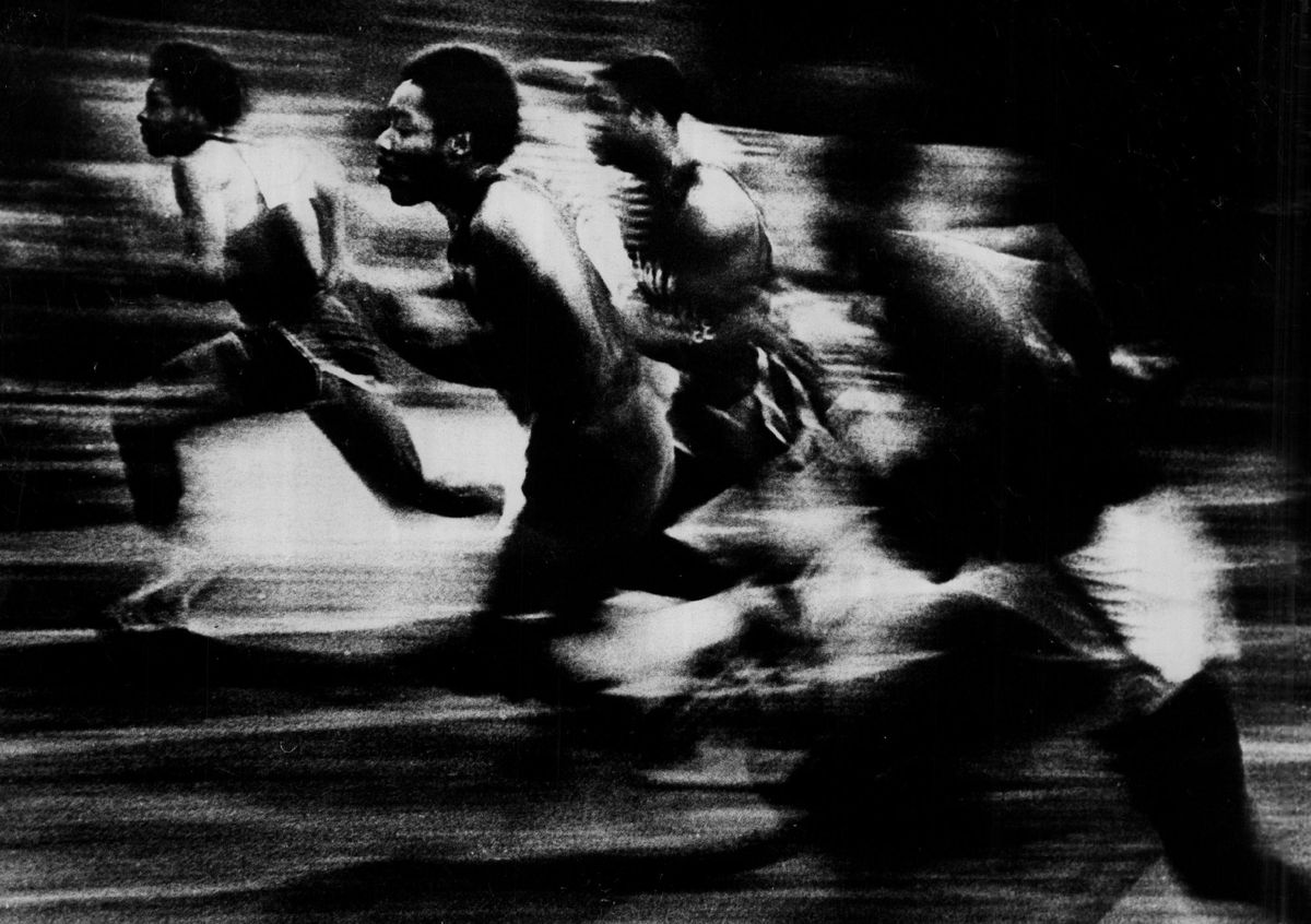"""Sun-Times photographer Jack Lenahan won a top prize for his picture """"Swish,"""" the 60-yard dash at a University of Chicago track meet."""