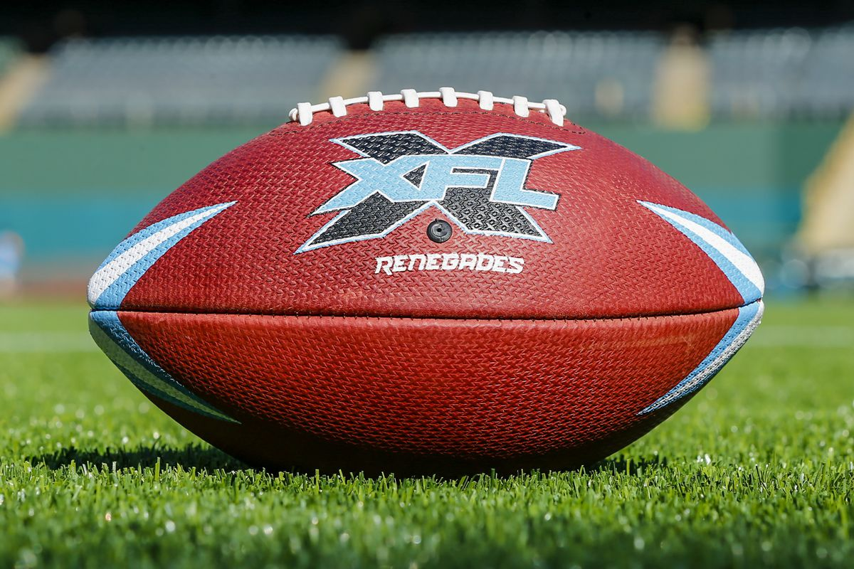 A Dallas Renegades football lays in the grass during the open practice for the XFL Dallas Renegades on February 1, 2020 at Globe Life Park in Arlington, Texas.