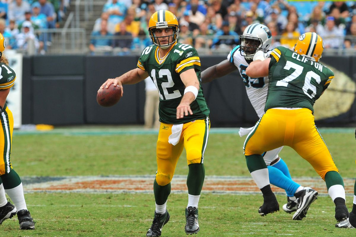 CHARLOTTE, NC - SEPTEMBER 18:  Quarterback Aaron Rodgers #12 of the Green Bay Packers sets to pass against the Carolina Panthers September 18, 2011 at Bank of America Stadium in Charlotte, North Carolina.  (Photo by Al Messerschmidt/Getty Images)