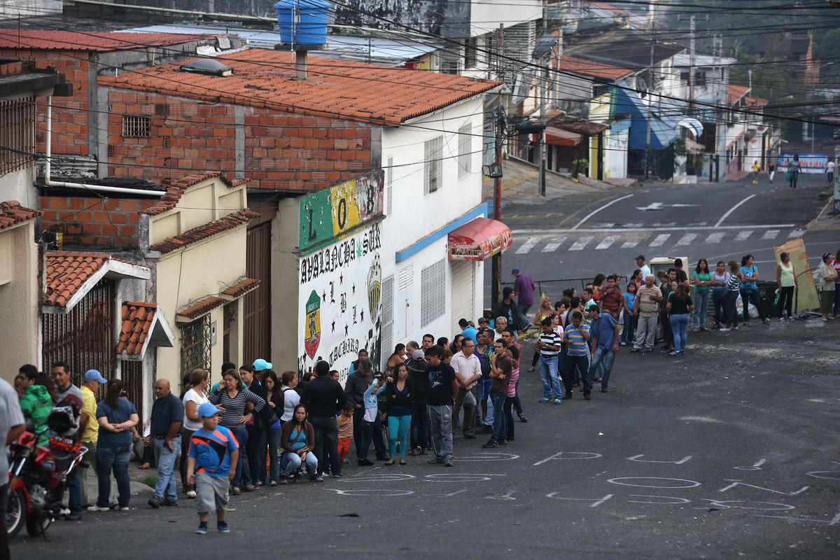 This is a line of people, up at dawn, to get into a supermarket and get basic foodstuffs before they run out.