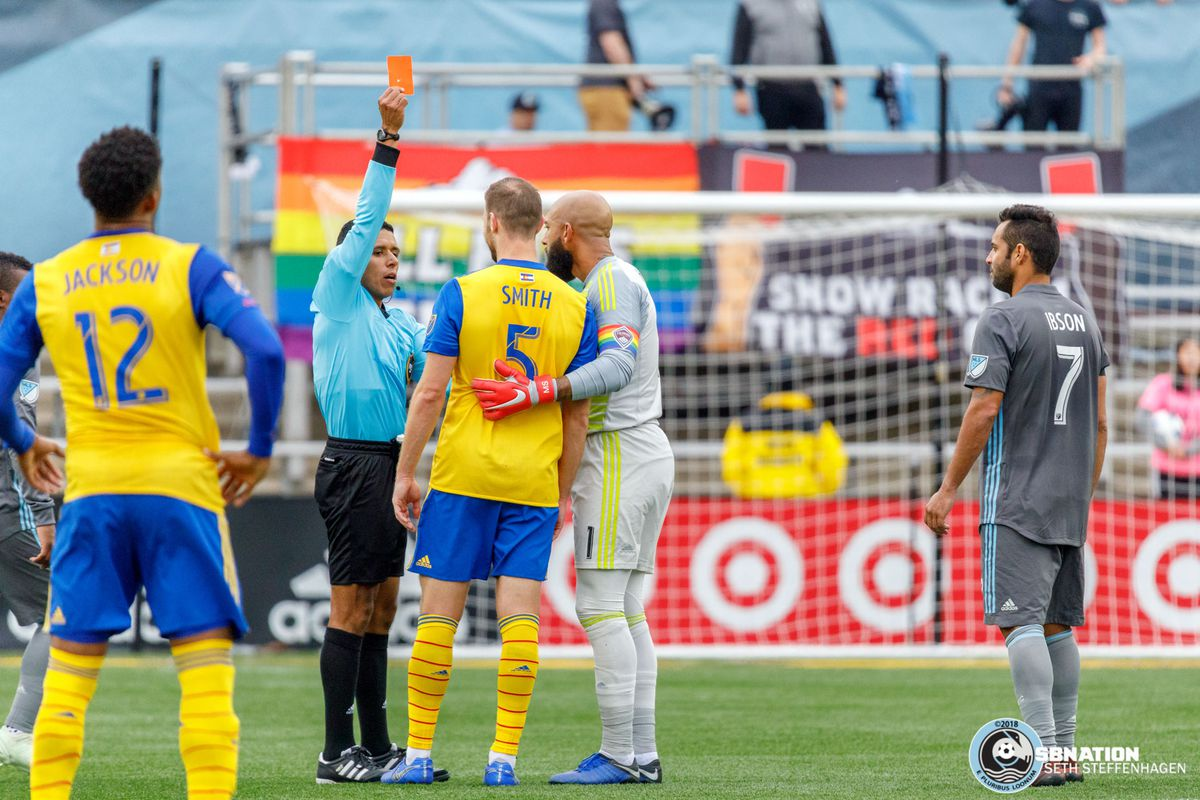 October 13, 2018 - Minneapolis, Minnesota, United States - Referee Guido Gonzales issues Colorado Rapids defender Tommy Smith (5) a red card for the involvement in the post goal fracas during the Minnesota United vs Colorado Rapids match at TCF Bank Stadium.