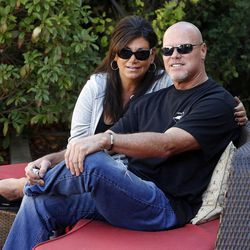 Jim McMahon and his girlfriend, Laurie Navon, pose for a portrait in Layton on Oct. 1.