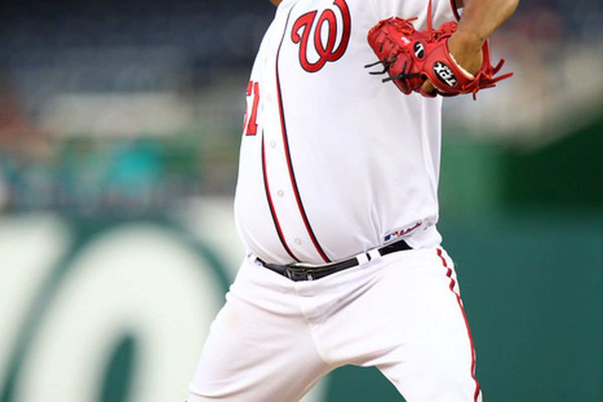 WASHINGTON, DC - JULY 27: Livan Hernandez #61 of the Washington Nationals delivers a pitch against the Florida Marlins at Nationals Park on July 27, 2011 in Washington, DC. (Photo by Ned Dishman/Getty Images)
