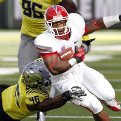 Fresno State running back Robbie Rouse, right, tries to get past Oregon defender Michael Clay during the first half of an NCAA college football game in Eugene, Ore., Saturday, Sept. 8, 2012.