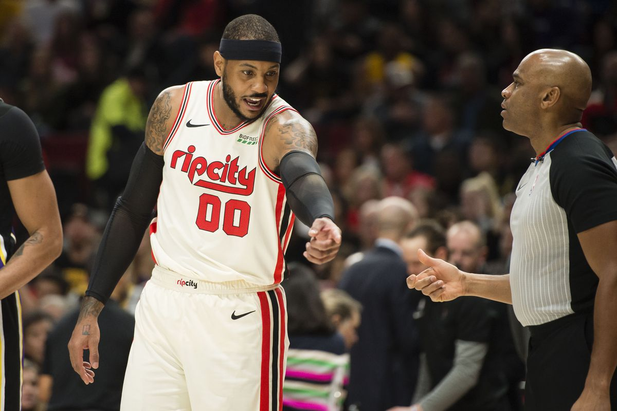 Portland Trail Blazers forward Carmelo Anthony complains to an official during the first half against the Los Angeles Lakers at Moda Center.