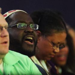 A RootsTech attendee sings along with the Calvary Baptist choir during the general session at the Salt Palace in Salt Lake City on Friday, Feb. 10, 2017.