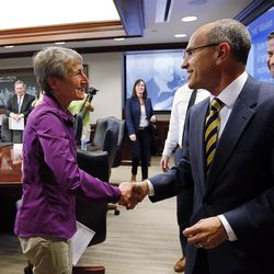 U.S. Secretary of the Interior Sally Jewell shakes hands with Paul Edwards, editor and publisher of the Deseret News Publishing Company, after meeting with the Deseret Media Companies Editorial Board in Salt Lake City, Wednesday, Aug. 5, 2015. At back right is Chris Lee, president of Deseret Digital Media Inc.