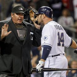 San Diego Padres' Mark Kotsay argues with home plate umpire Hunter Wendelstedt after being called out on strikes to end the seventh inning with two runners on base during a baseball game against the Philadelphia Phillies, Thursday, April 19, 2012, in San Diego.