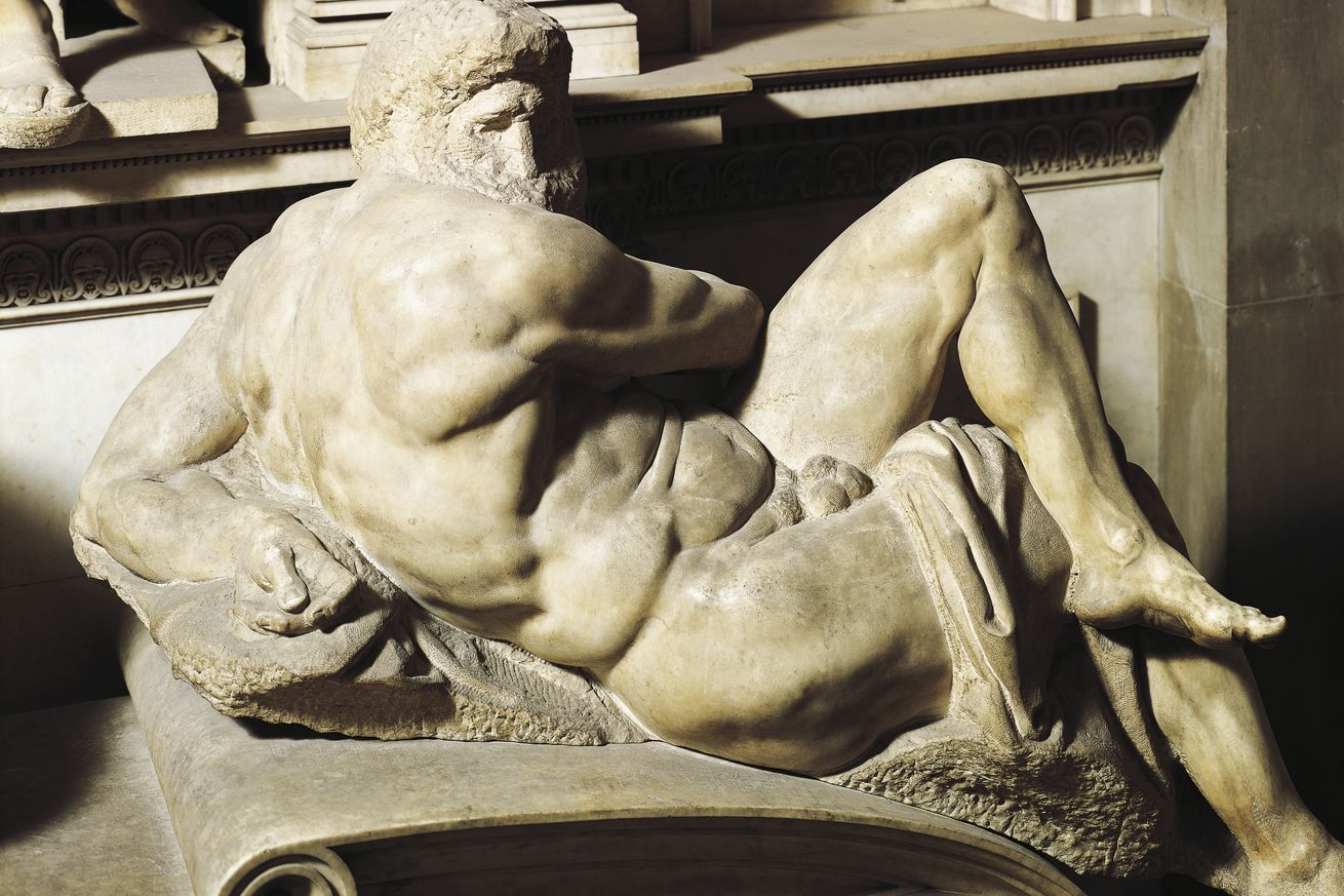A marble sculpture of a nude bearded man reclining