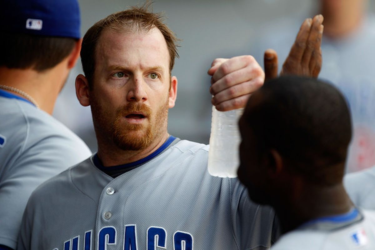 Starting pitcher Ryan Dempster of the Chicago Cubs is congratulated by teammates in the dugout after the 7th inning of a game against the Chicago White Sox at U.S. Cellular Field. (Photo by Jonathan Daniel/Getty Images)