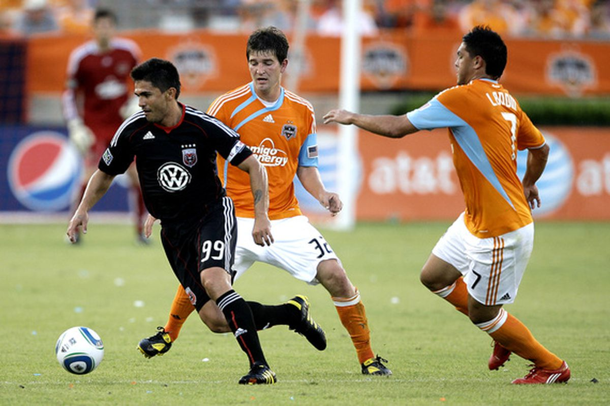 HOUSTON - MAY 22:  Jaime Moreno #99 of D.C. United splits the defense of Bobby Boswell #32 and Luis Landin #7 of the Houston Dynamo at Robertson Stadium  on May 22, 2010 in Houston, Texas. Houston won 2-0.  (Photo by Bob Levey/Getty Images)