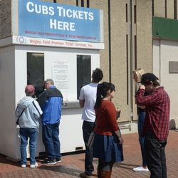 11:23 a.m. Customers at the Wrigley Field Premium Tickets booth on Addison -