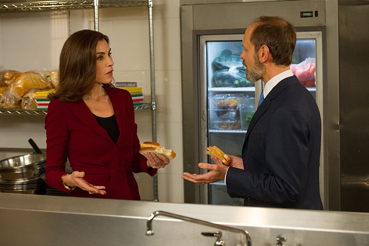 Alicia (Julianna Margulies) argues with Frank (David Hyde Pierce) backstage at the debate.