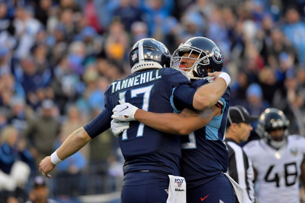 Tennessee Titans quarterback Ryan Tannehill reacts with teammate Tennessee Titans tight end MyCole Pruitt after scoring a touchdown against the Jacksonville Jaguars during the first half at Nissan Stadium.
