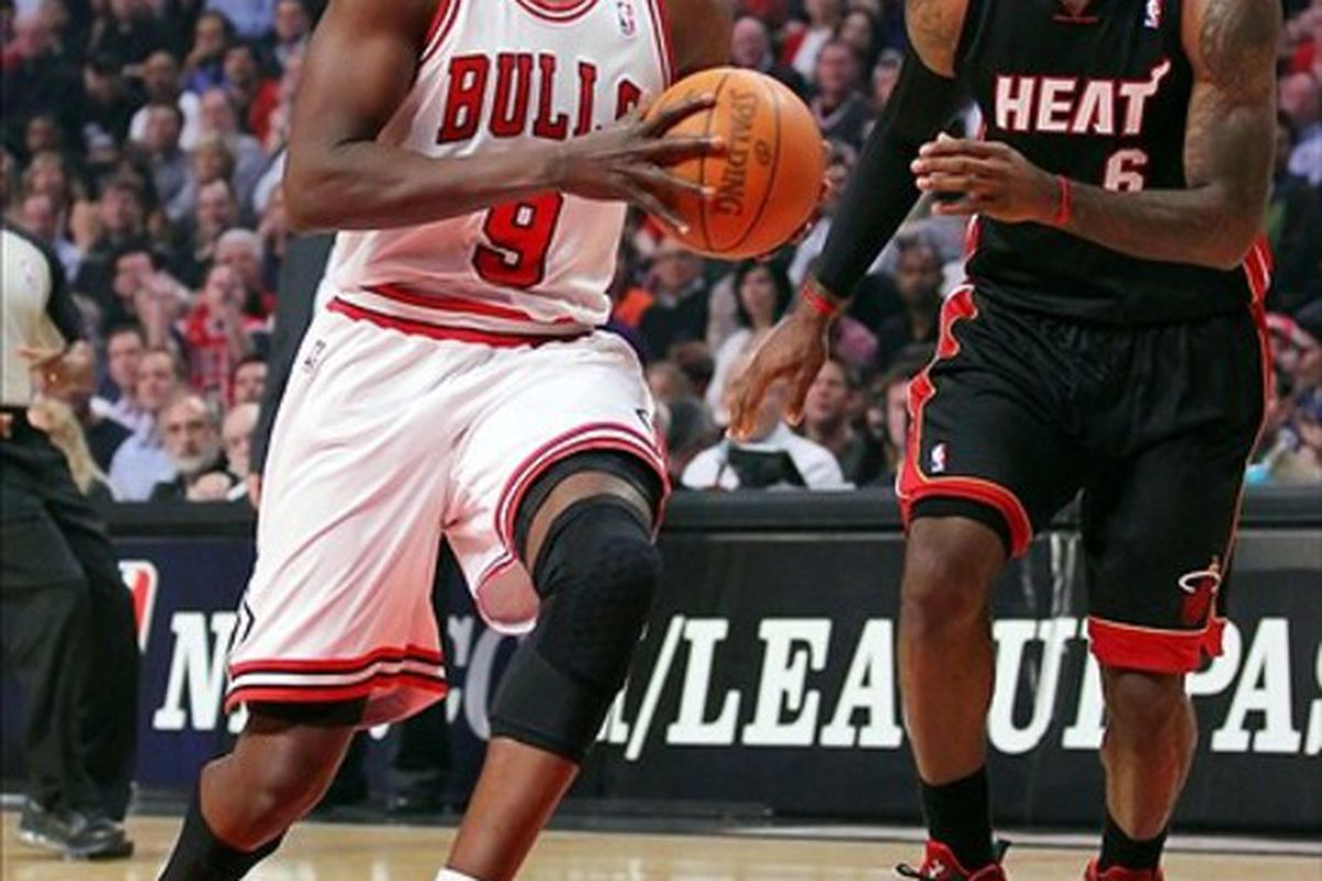 Mar 14, 2012; Chicago, IL, USA; Chicago Bulls small forward Luol Deng (9) drives past Miami Heat small forward LeBron James (6) in the first quarter at the United Center. Mandatory Credit: Dennis Wierzbicki-US PRESSWIRE