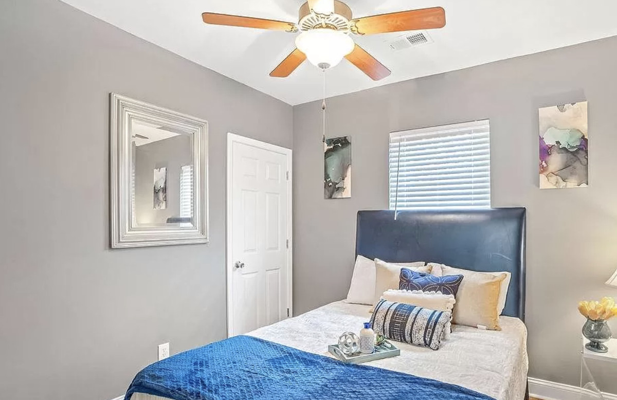 Bedroom with bed, nightstand and lamp.