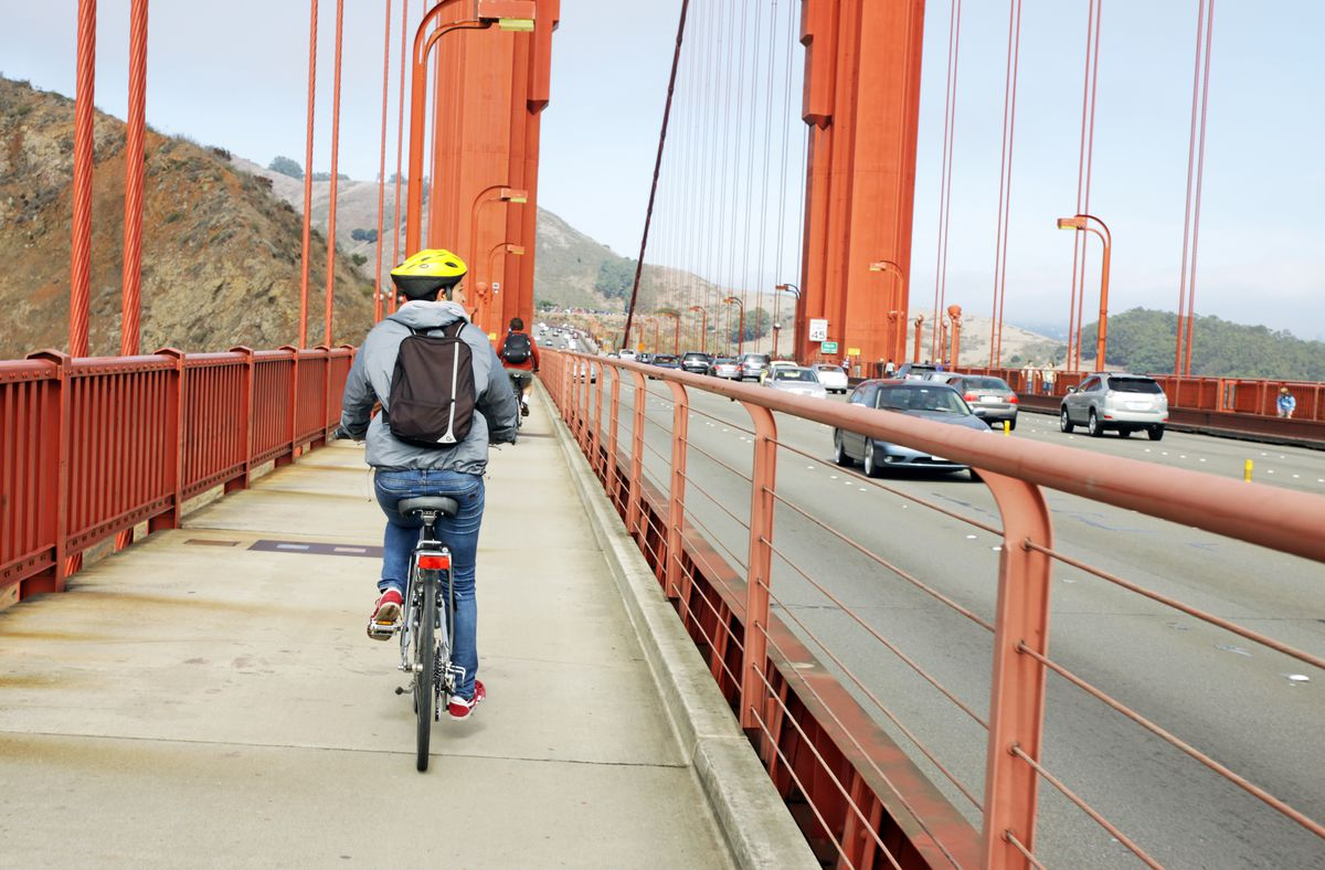 Cyclist on the Golden Gate Bridge sidewalk.