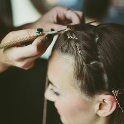 """""""This particular bride bought different styles of chains from local markets and Etsy. We mixed and matched thick and thin, gold and silver, and I hand-sewed the chains into her hair.""""  <br></br> [Image credit: <a href=""""http://www.katchsilva.com/"""">Katch"""