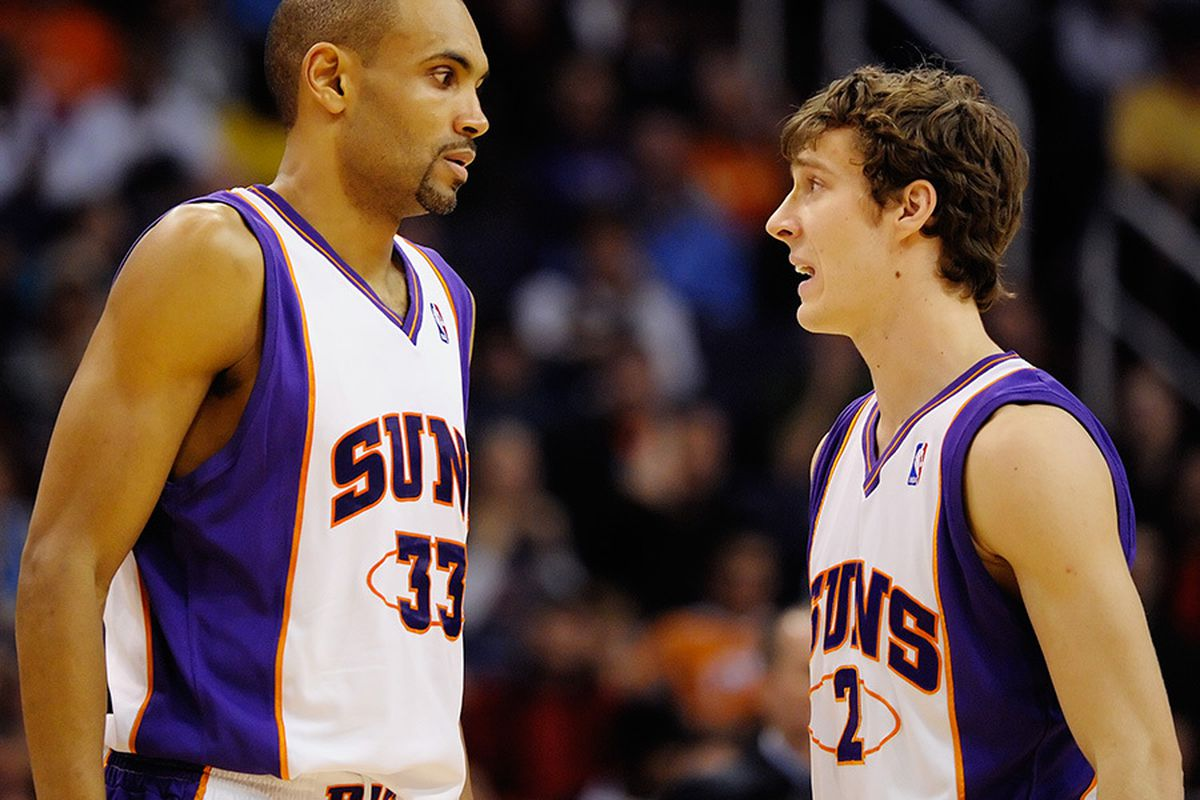 Suns backup point guard Goran Dragic talks strategy with backup to the backup point guard Grant Hill. The Suns might even be forced to give the ball to 4th backup point guard, Jared Dudley. Should be fun. (Photo by Max Simbron)
