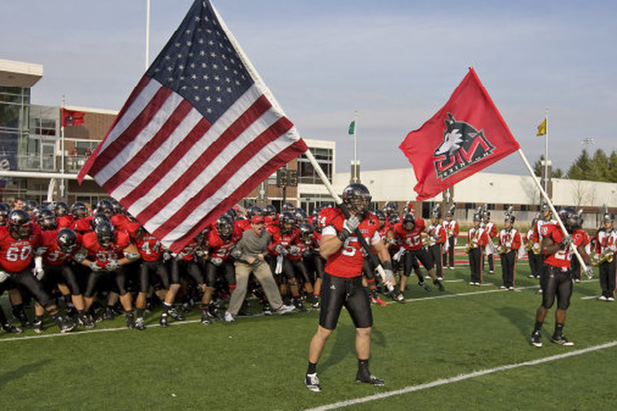"""Follow Jake Coffman whenever he's carrying a flag — and you, too, will rise to No. 1. (<a href=""""http://www.niuhuskies.com/sports/m-footbl/recaps/102310aaa.html"""" target=""""new"""">Photo via niuhuskies.com</a>)"""