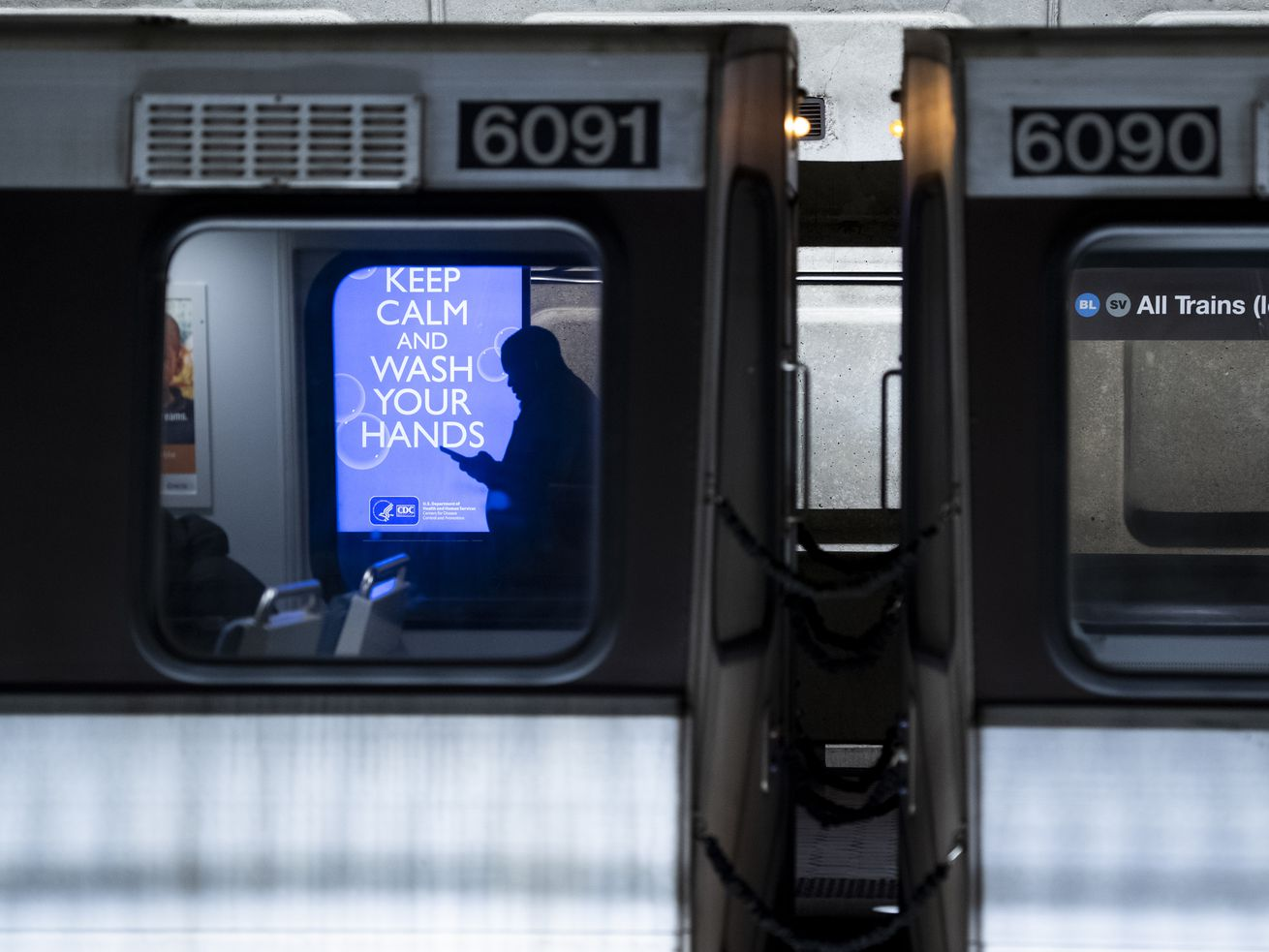 An electronic ad in the from the Centers for Disease Control advises commuters and tourists in the Metro Center subway station in Washington to keep calm and wash your hands.