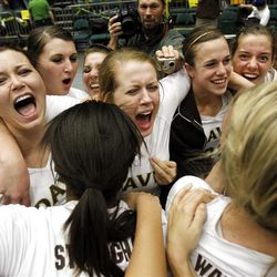 Davis celebrates as they defeat Lehi Saturday, Nov. 5, 2011 for the 5A Volleyball Championship at Utah Valley University in Orem.