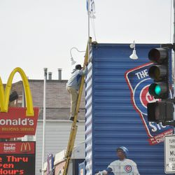 """""""W"""" flag being raised above the Cubs Store on Clark Street -"""
