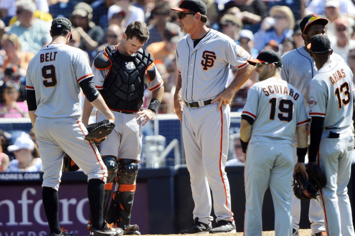 August 19, 2012; San Diego, CA, USA; San Francisco Giants manager Bruce Bochy (center) makes a pitching change during the fifth inning against the San Diego Padres at Petco Park.  Mandatory Credit: Christopher Hanewinckel-US PRESSWIRE