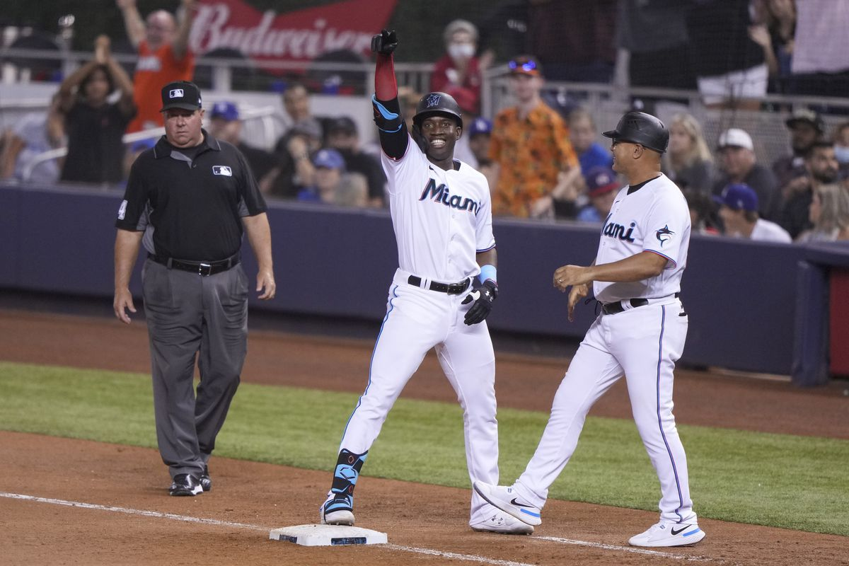 Jesus Sanchez #76 of the Miami Marlins points to the bench after hitting an RBI single in the eighth inning against the Los Angeles Dodgers at loanDepot park
