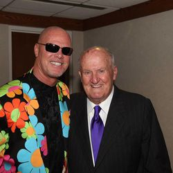 Former BYU quarterback Jim McMahon, left, poses with former BYU football coach LaVell Edwards. McMahon was one of five former All-Americans enshrined into the BYU Athletic Hall of Fame Thursday.