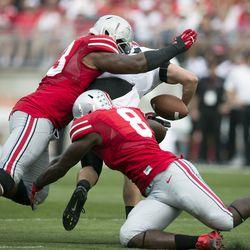 Michael Bennett and Noah Spence get to the opposing quarterback.