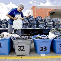 Jose Caldero organizes hundreds of pairs of jeans for sale Sunday at the Swap Meet in West Valley City. The swap meet is held on Saturdays and Sundays.