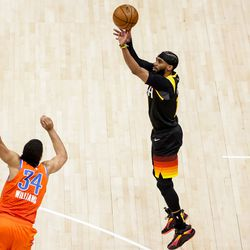Utah Jazz guard Mike Conley (10) shoots over Oklahoma City Thunder forward Kenrich Williams (34) during the game at Vivint Smart Home Arena in Salt Lake City on Tuesday, April 13, 2021.