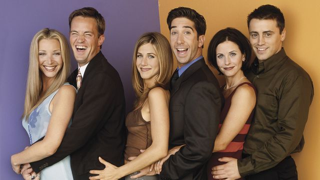 the cast of Friends holding each other at the waist like in a prom photo