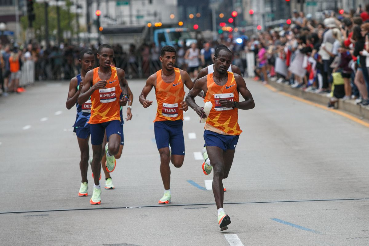 The first wave of runners head along Wacker Drive early in the Chicago Marathon on Sunday. Oct. 10, 2021.