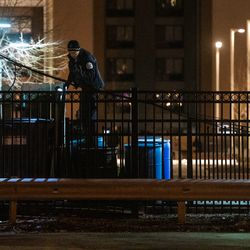 Chicago Police investigate the scene where two people where shot Saturday morning near Huron and Clark.   Tyler LaRiviere/Sun-Times
