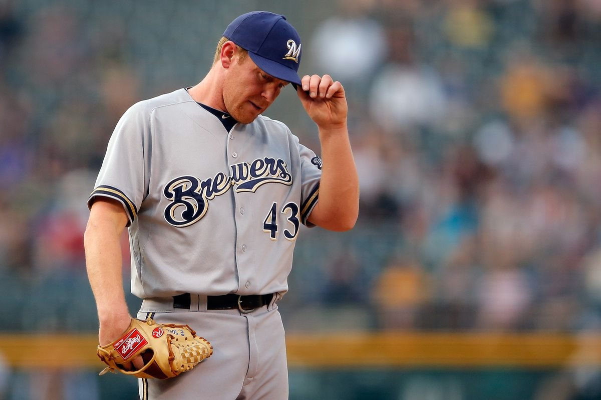 DENVER, CO - AUGUST 14:  Starting pitcher Randy Wolf #43 of the Milwaukee Brewers pauses as he works against the the Colorado Rockies in the first inning at Coors Field on August 14, 2012 in Denver, Colorado.  (Photo by Doug Pensinger/Getty Images)